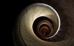 371_downward_spiral-250x155